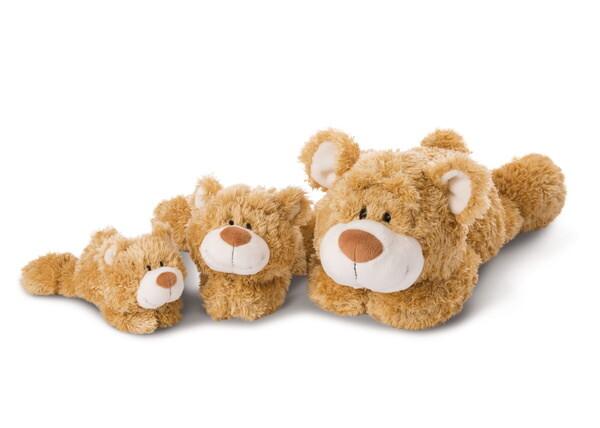 Cuddly toy bear lying Classic Bear