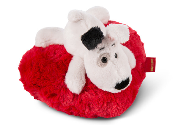 Cuddly toy Love dog on heart-shaped cushion